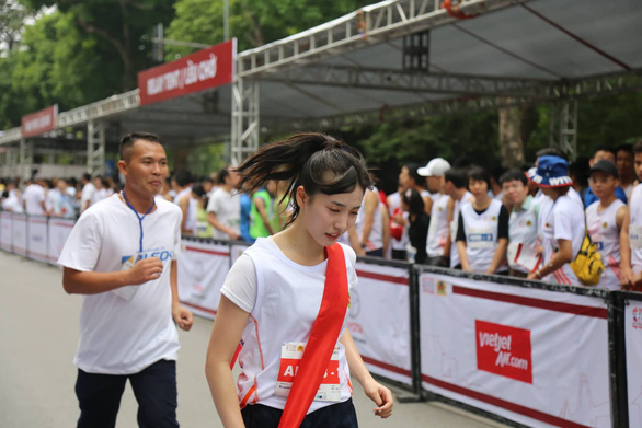 Member of Japanese girl group AKB48 runs at the event.