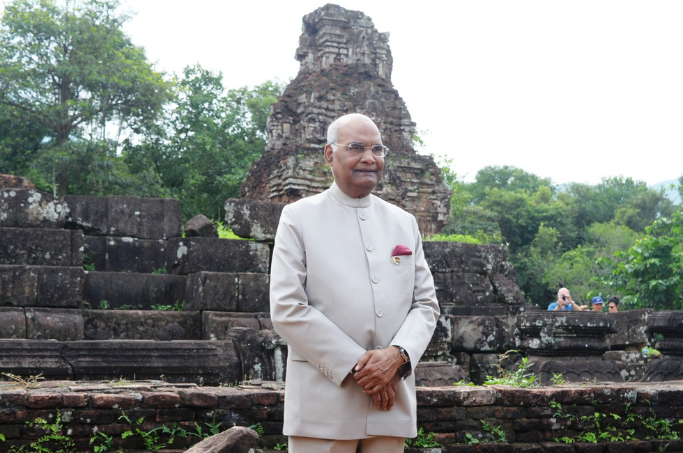 The Indian leader poses for a photo with a tower within the sanctuary.