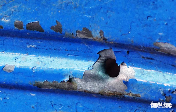 A hole caused by a bullet at the scene. Photo: Tuoi Tre