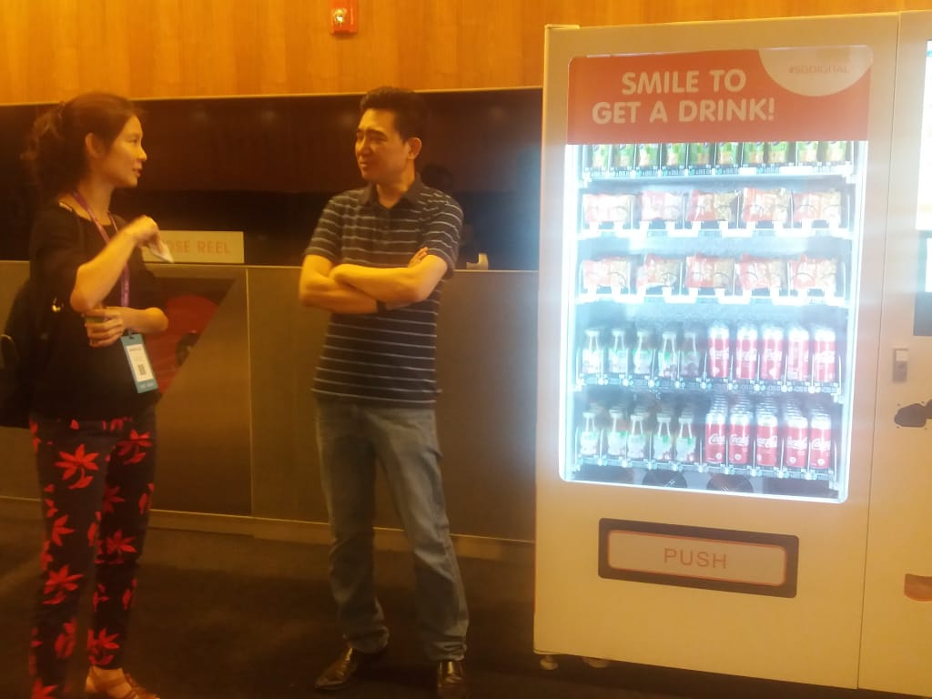 A 'smile to drink' vending machine showcased at the event. Photo: Liem Nguyen
