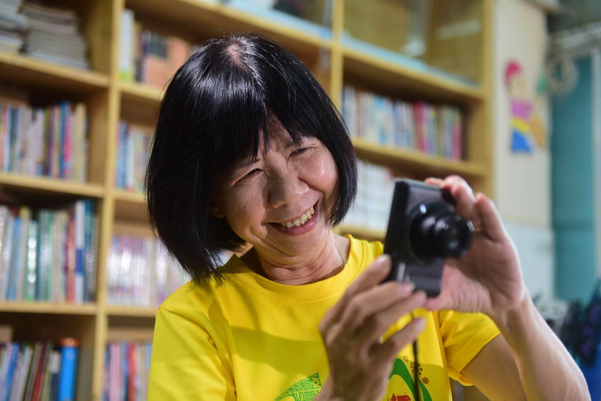 Dinh Thi Kim Phan takes pictures in a classroom at the Ho Chi Minh City Oncology Hospital in Ho Chi Minh City, Vietnam. Photo: Tuoi Tre