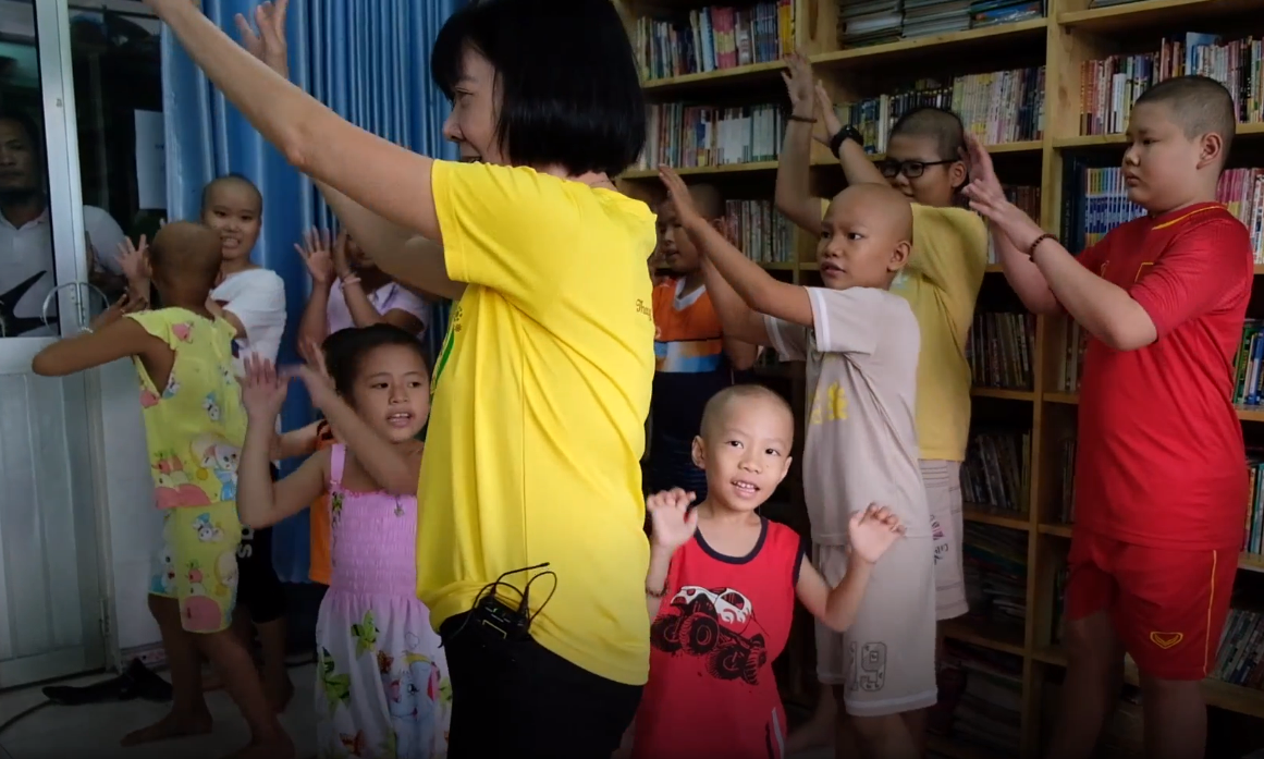 Dinh Thi Kim Phan dances with her students at the Ho Chi Minh City Oncology Hospital in Ho Chi Minh City, Vietnam. Photo: Tuoi Tre