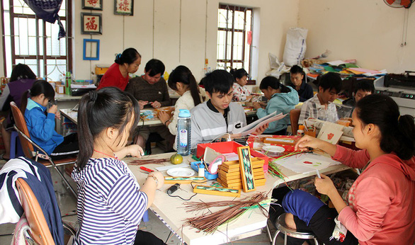 Nguyen Thi Thu Thuong's employees at their workshop in Hanoi, Vietnam. Photo: Tuoi Tre