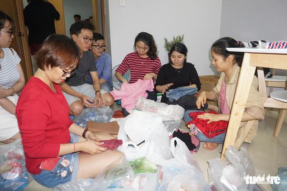 Young people fold clothes as gifts for the homeless in Ho Chi Minh City, Vietnam. Photo: Tuoi Tre