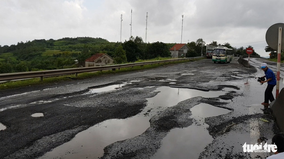 National highway in south-central Vietnam ruined by giant potholes