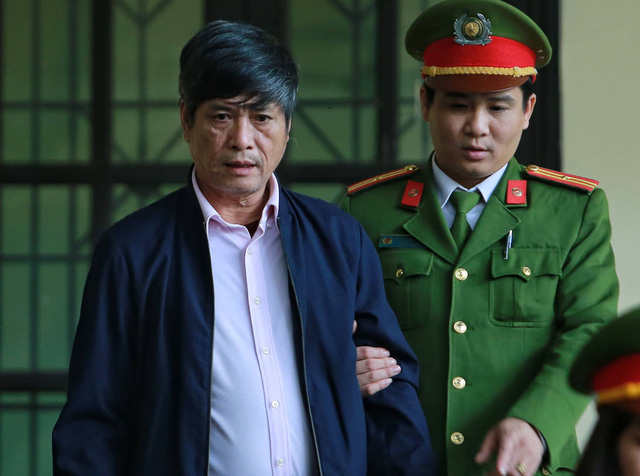 Vietnam's former top cops get 9-10 yrs for backing online gambling ring