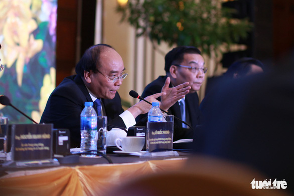 Prime Minister Nguyen Xuan Phuc answers questions from participants. Photo: Tuoi Tre