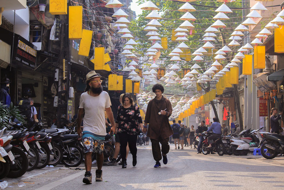 Vietnamese conical hats are hung over Dao Duy Tu Street in Hanoi. Photo: Tuoi Tre