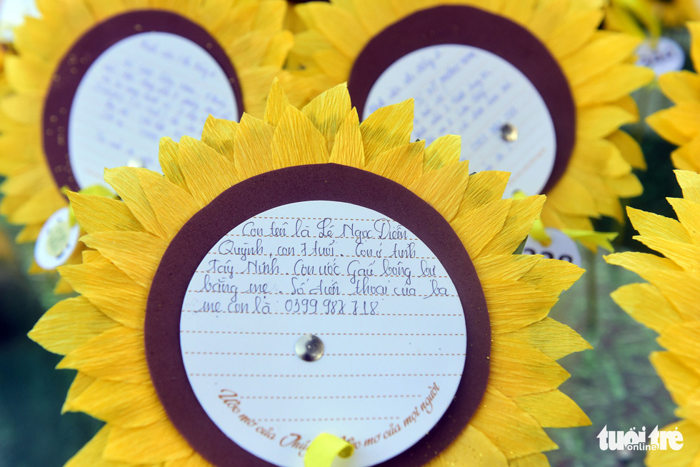A sunflower features a wish of seven-year-old Le Ngoc Diem at the 'Wish Garden.'