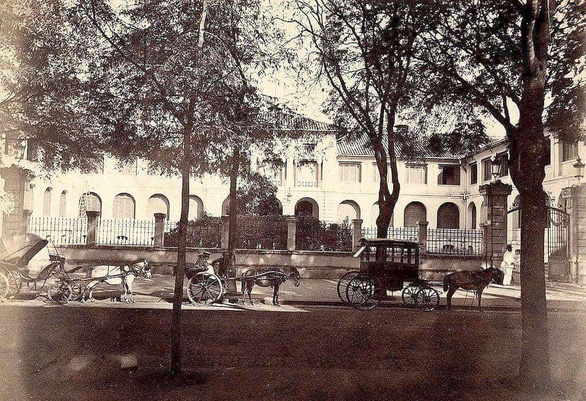 Horse-drawn carriages are seen in front of Thuong Tho Palace, built in the 1860s in Saigon during the French colonial rule, in this file photo.