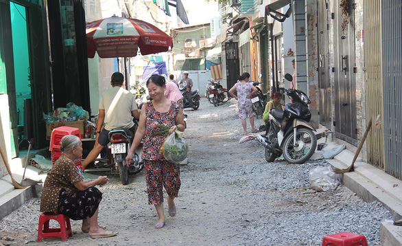 Ho Chi Minh City residents willingly give up land for alley expansion