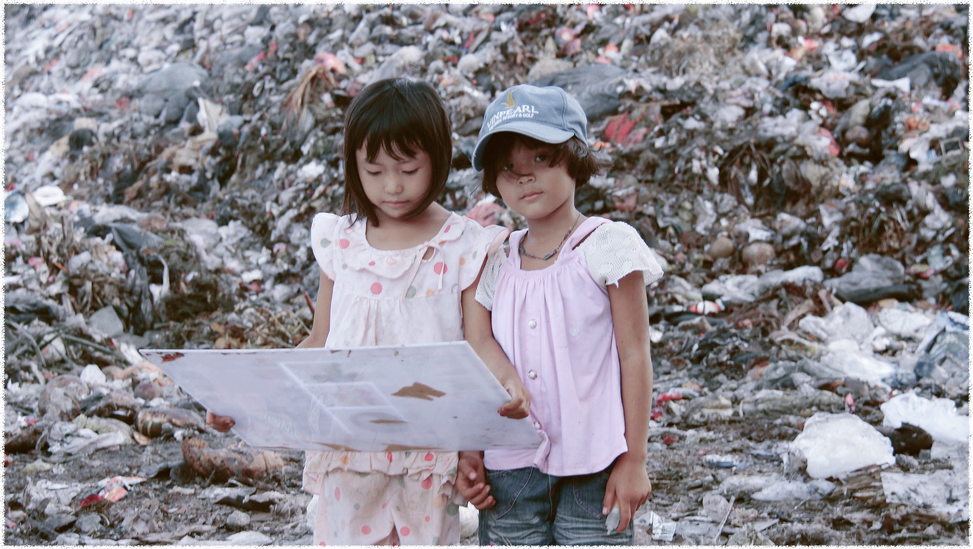 Many children now live in makeshift camp sites around trash dumps on Phu Quoc Island, off southern Vietnam, as their parents eke out their living here. Photo: Tuoi Tre