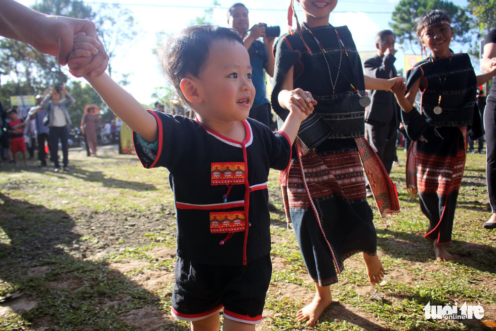 A little kid dances to celebrate new communal houses at the gong festival in the Central Highlands province of Gia Lai. Photo: Tuoi Tre