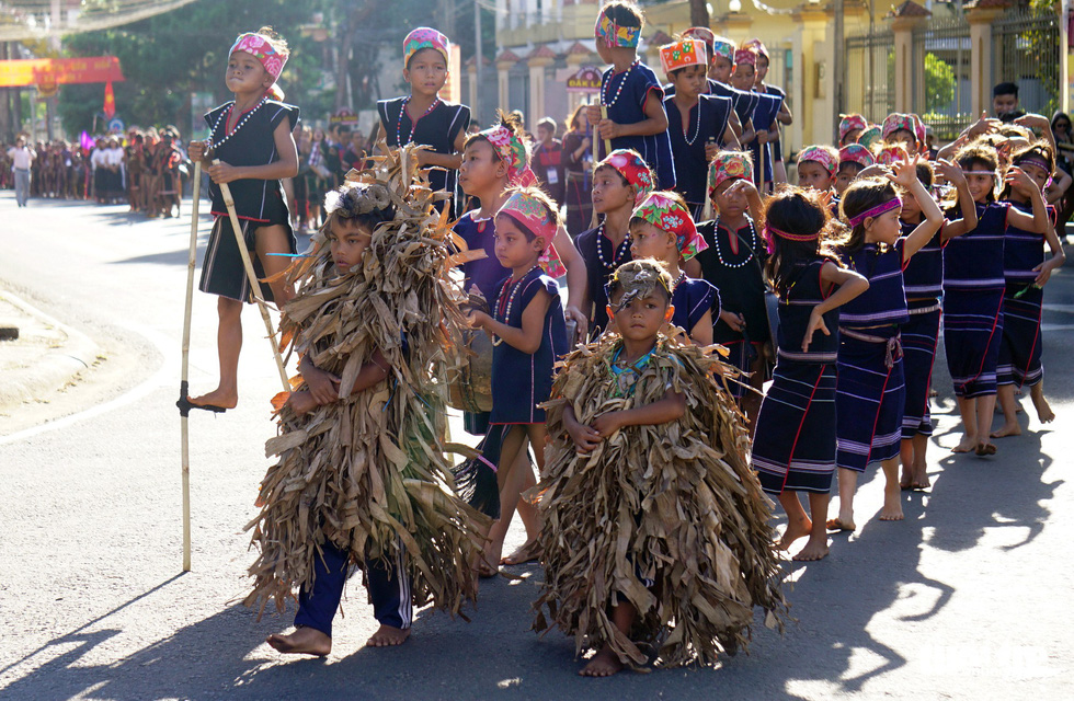 Children dress up as beasts in a street parade - one of the activities at the Gong Festival in the Central Highlands province of Gia Lai. Photo: Tuoi Tre