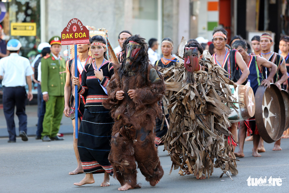 Artists dress up as beasts in a street parade - one of the activities at the Gong Festival in the Central Highlands province of Gia Lai. Photo: Tuoi Tre