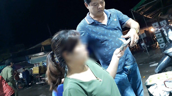 Duong Quoc Vuong collects protection money in the video footage previously published by the Vietnam Television (VTV).