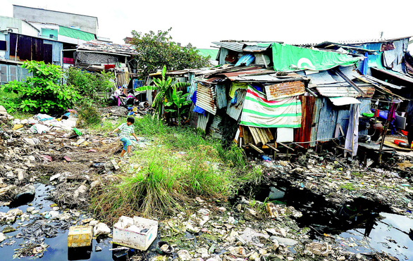 Canals encroached on by houses, blocked by garbage in Ho Chi Minh City