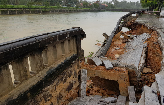 A dyke in the north-central province of Quang Tri is heavily damaged by prolonged downpour.