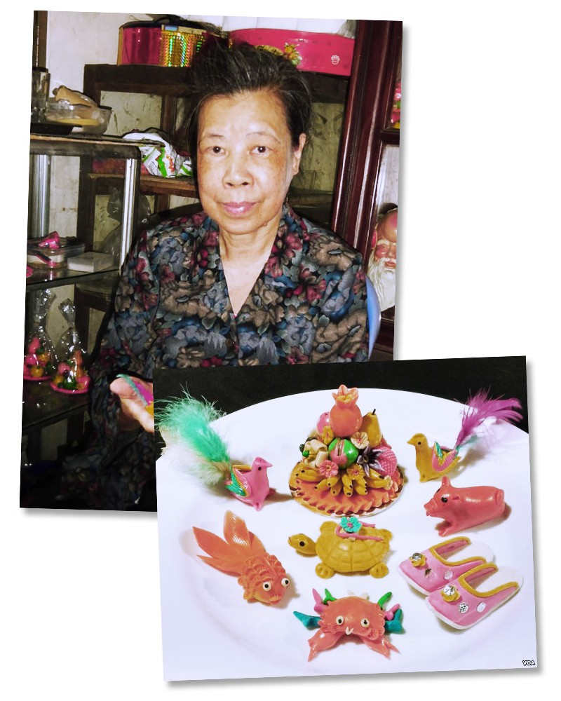 Pham Nguyet Anh with some of her typical Dong Xuan powder figurines. Photo: Trinh Bach