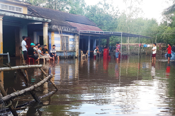 Duoc's house was still submerged in flood water after his passing.