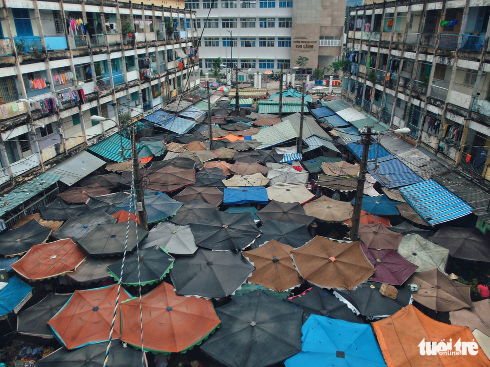 The Hang Phan apartment building and the umbrellas covering the market below in Ho Chi Minh City, Vietnam. Photo: Tuoi Tre