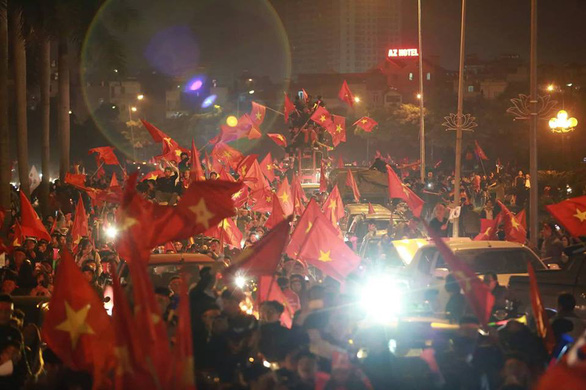 Crowds gather on a street to celebrate Vietnam's win in the ASEAN Football Federation (AFF) Championship final, in Hanoi, December 15, 2018. Photo: Tuoi Tre