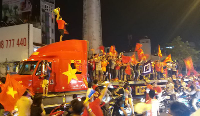 Football fans celebrate on top of a tractor-trailer in Ho Chi Minh City. Photo: Tuoi Tre