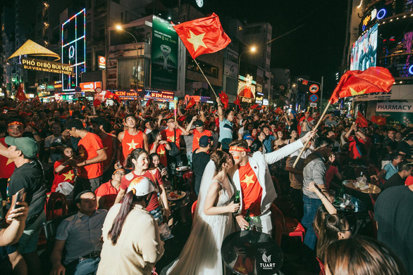 A wedding photo captures Nam and Tien amid the wild celebrations of thousands of Vietnamese fans on December 15, 2018