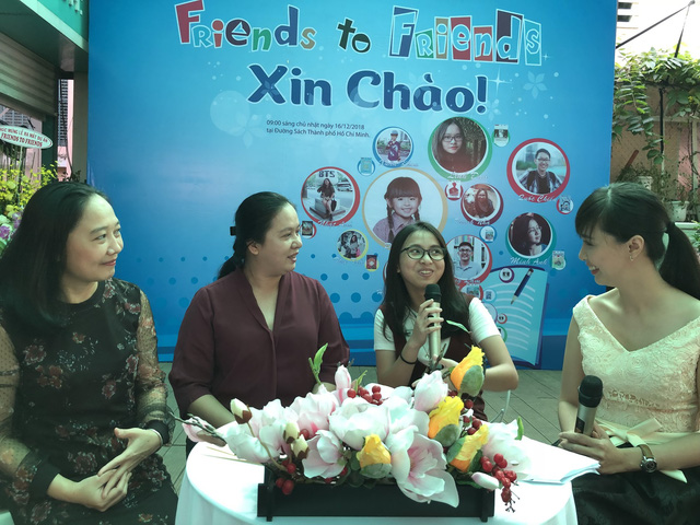 Ngo Thanh Nha (second right) shares thoughts about her comic, 'Big Brother's Shadow', at the project's debut fair.