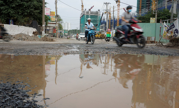 A road surface in Ho Chi Minh City is left rugged after open-cut underground works. Photo: Tuoi Tre