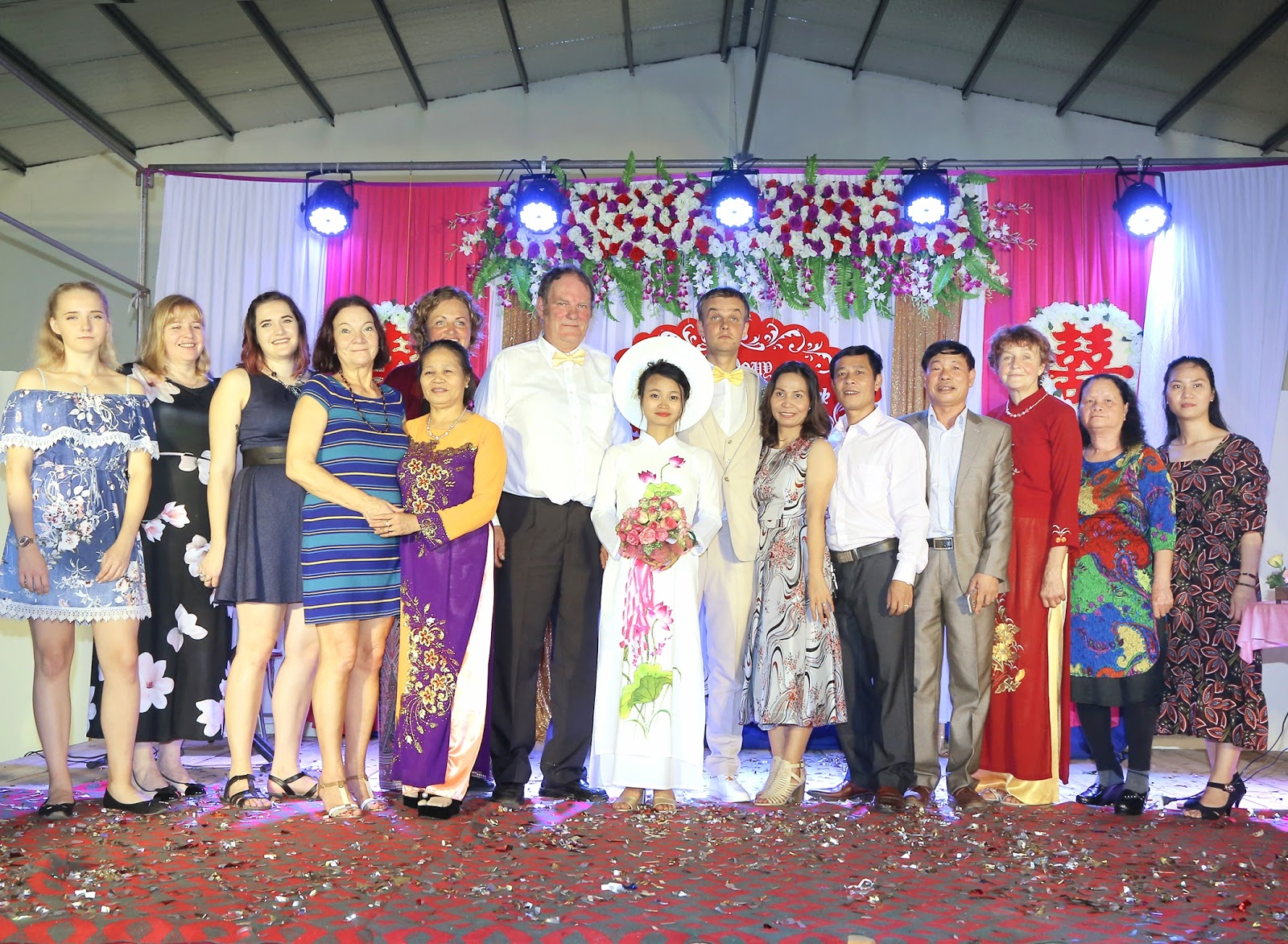 Nguyen Thi Sam, Meigo Mark and their families at the couple's wedding in a photo provided by Meigo Mark