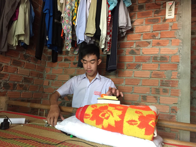 Nguyen Tan Hieu sits in the study corner of his humble house in Quang Nam, central Vietnam. Photo: Tuoi Tre