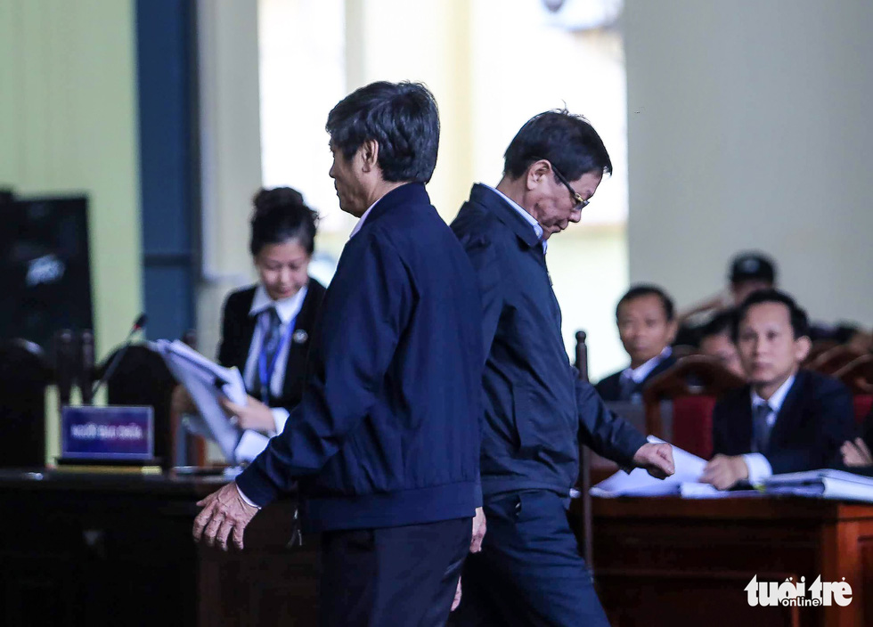 Phan Van Vinh (right) and Nguyen Thanh Hoa (left), both former senior police officials, go past each other in a courtroom. On November 30, 2018, a court in the northern province of Phu Tho sentenced Vinh to nine years in prison and Hoa to ten years behind bars for abusing their powers in office. Each of them was required to pay a VND100 million (US$4,300) fine as a side punishment. The two had been found backing an online gambling ring from behind the scenes. A total of 92 defendants had to stood trial in this scandal that rocked the country with over VND9 trillion ($388.6 million) in illegal gambling revenue recorded by authorities.