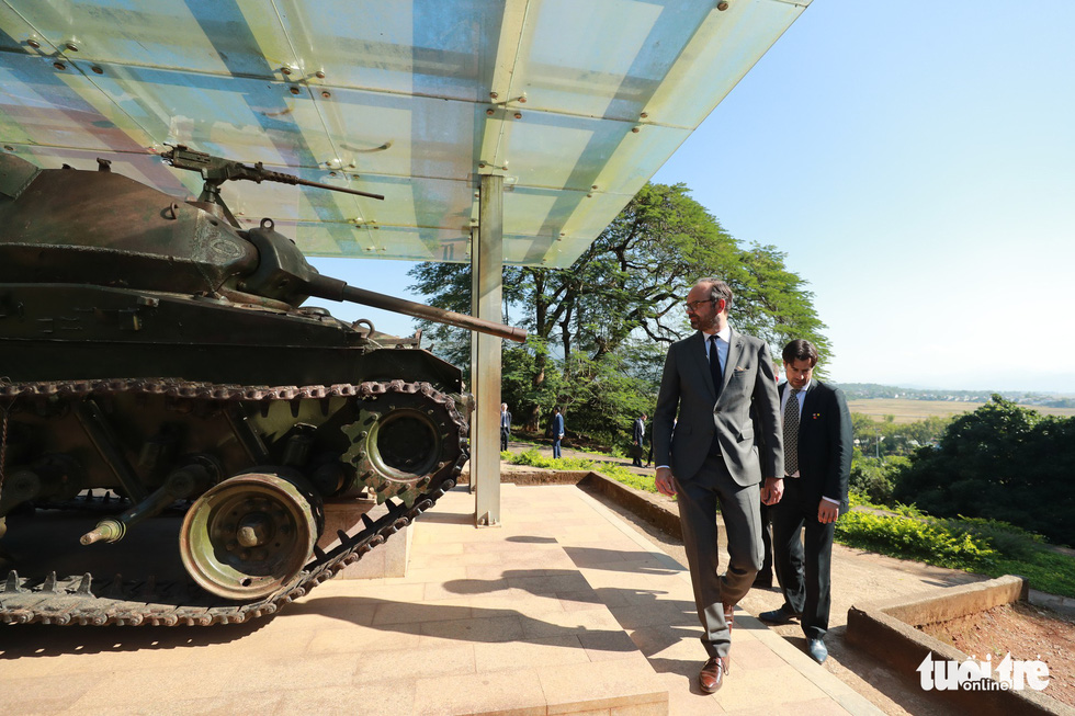 French Prime Minister Édouard Philippe looks at an old tank utilized by the French military at Dien Bien Phu in Vietnam during wartime. The official visited Vietnam from November 2 to 4, 2018.
