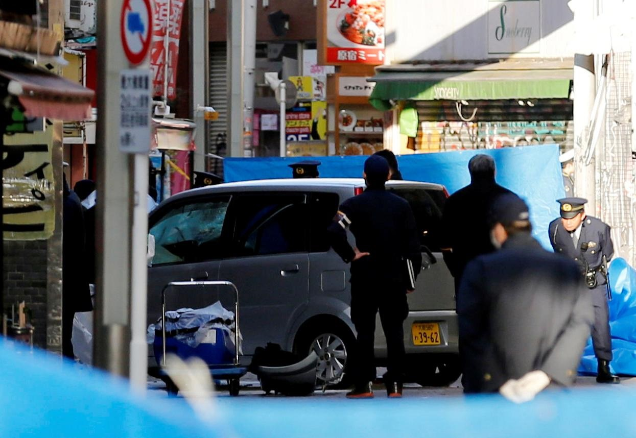 Car crashes into New Year's crowd in Tokyo in suspected terror attack, eight injured