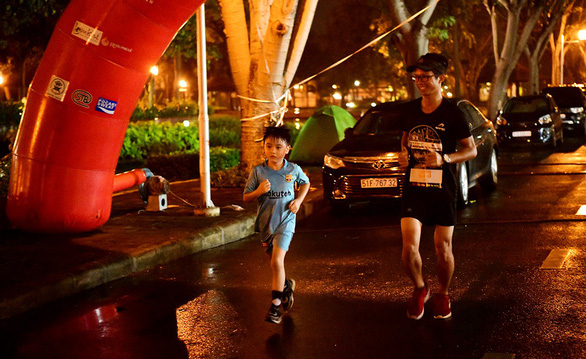 A young boy participates in the run. Photo: Tuoi Tre