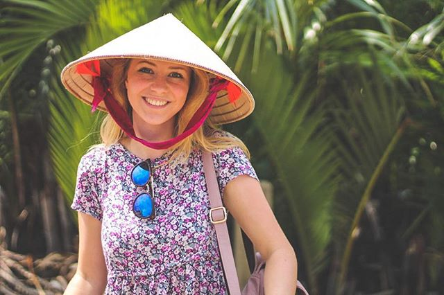 Frances wears a non la (Vietnamese conical hat) in a photo posted on Instagram handle of @so_theadventurebegins