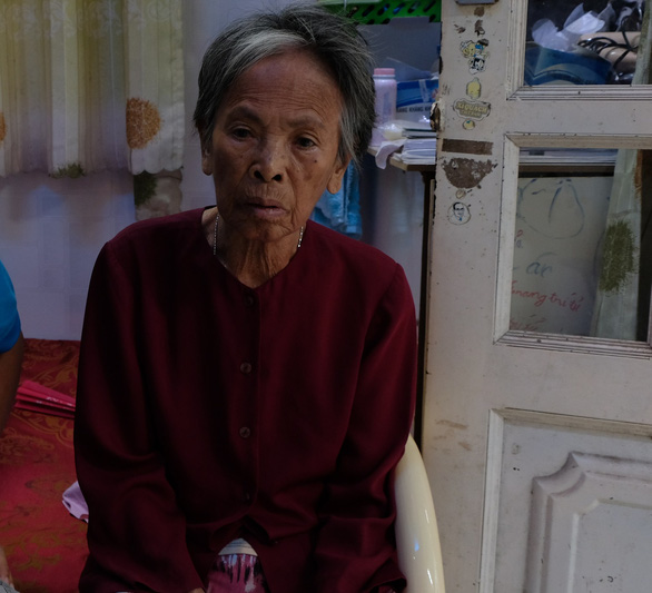 Tran Thi Thu sits in Cao Quoc Tri's house in Ho Chi Minh City, Vietnam. Photo: Tuoi Tre
