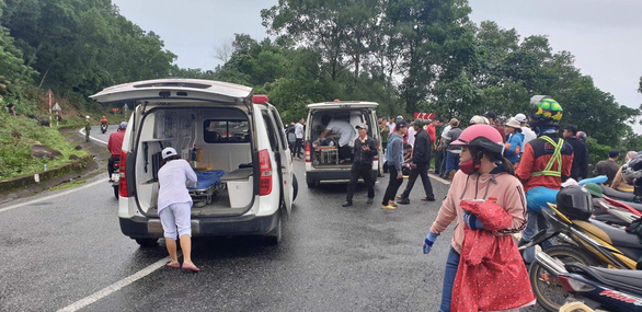 An ambulance is parked near the site of the accident. Photo: Tuoi Tre