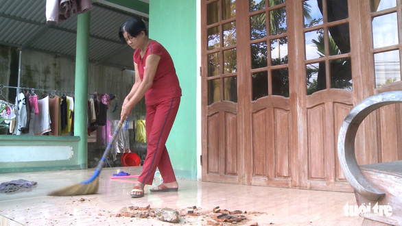 A woman cleans her home after the blast. Photo: Tuoi Tre