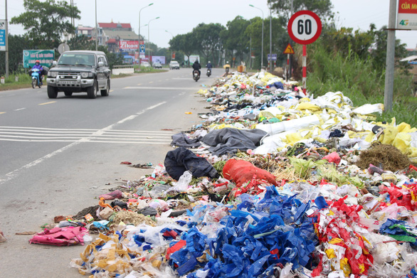 Piles of illegally dumped trash occupied Hanoi street