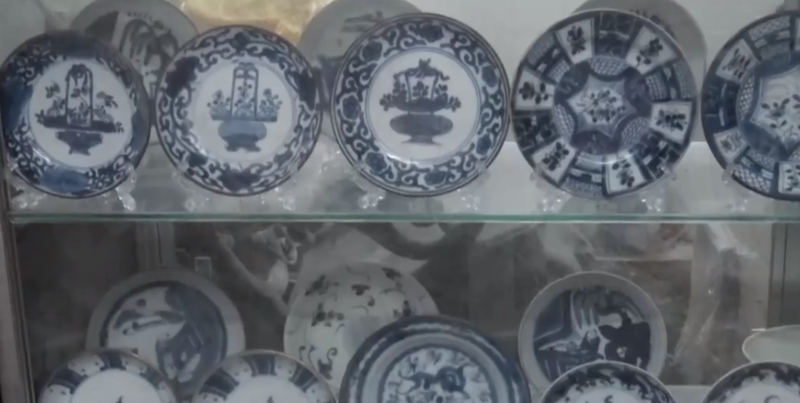 Dinh Cong Tuong displays antique plates at his building in Ho Chi Minh City, Vietnam. Photo: Tuoi Tre