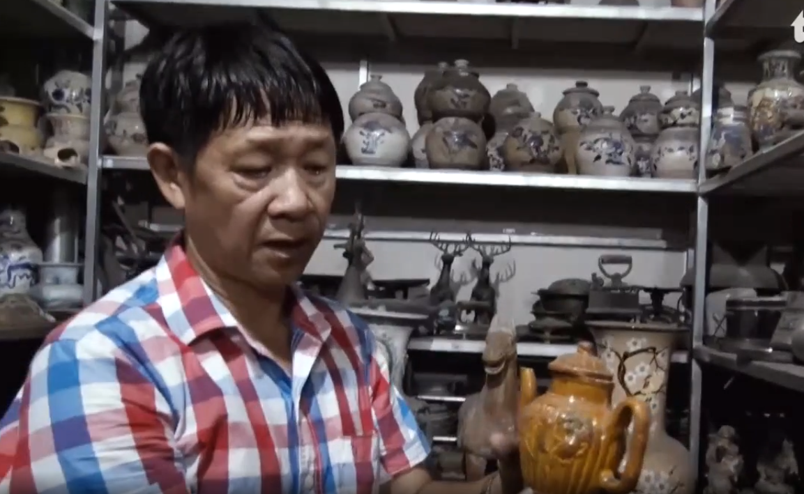 Dinh Cong Tuong displays an ancient Chinese pot at his building in Ho Chi Minh City, Vietnam. Photo: Tuoi Tre