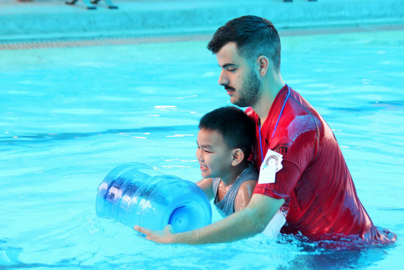 Australia-backed project teaches kids how to swim, save drowning victims in Vietnam's Mekong Delta