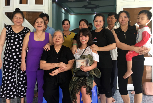 Lysiane Danièle (right sitting) and her Vietnamese relatives pose for a picture in Ba Ria-Vung Tau Province, southern Vietnam, January 15, 2019. Photo: Tuoi Tre
