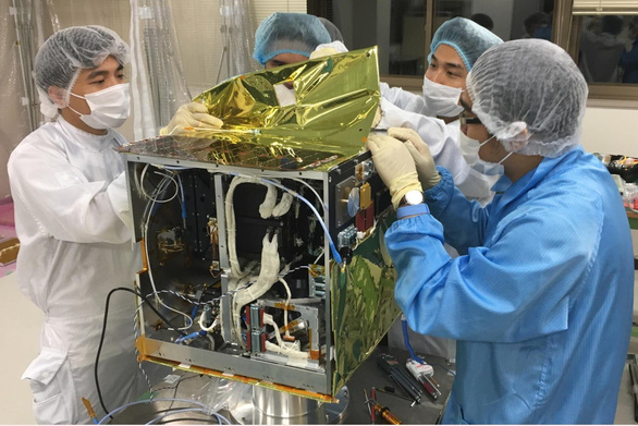 Vietnamese engineers install MicroDragon. Photo: Vietnam National Space Center