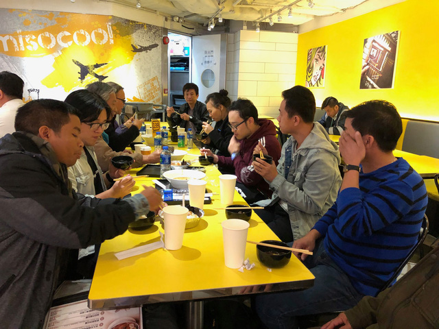Vietnamese passengers of American Airlines have a meal at the Hong Kong International Airport, Hong Kong. Photo: Tuoi Tre
