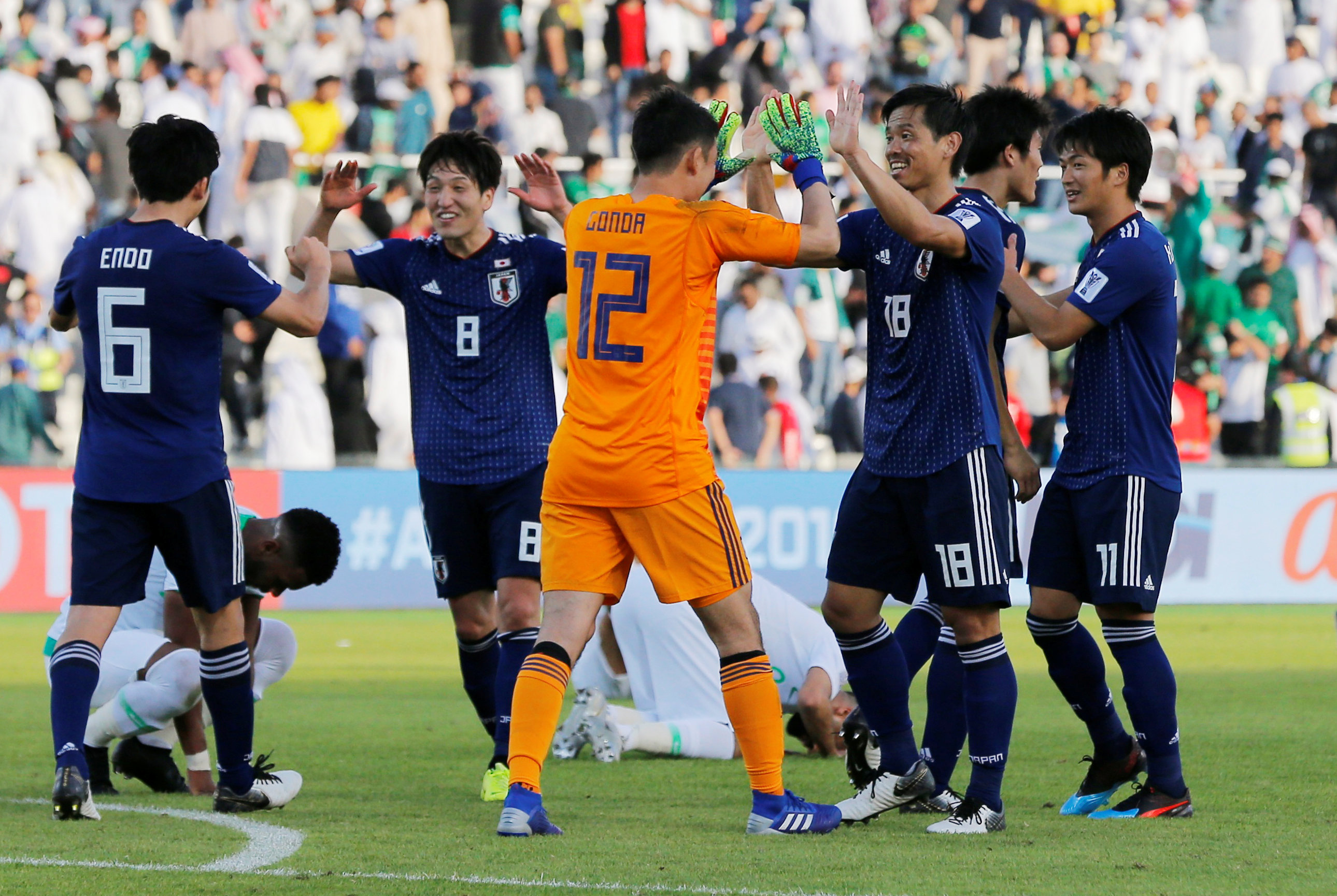 Japan edge profligate Saudis to meet Vietnam in Asian Cup quarter-finals