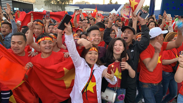 Vietnamese fans celebrate outside the the Al Maktoum Stadium in Dubai on January 20, 2019. Photo: Khoi Tran/ Tuoi Tre