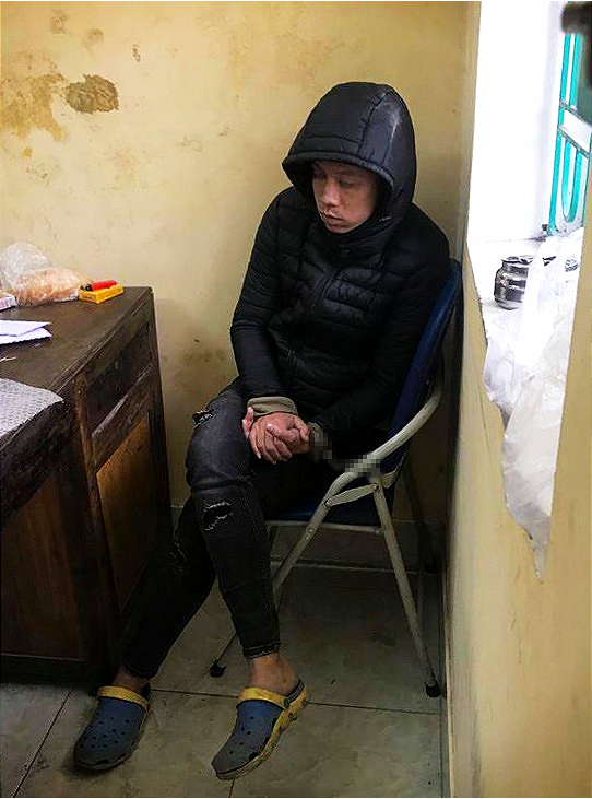 Truong Van Tam at the police station in Kim Thanh District, Hai Duong Province. Photo: Nguyen Son / Tuoi Tre